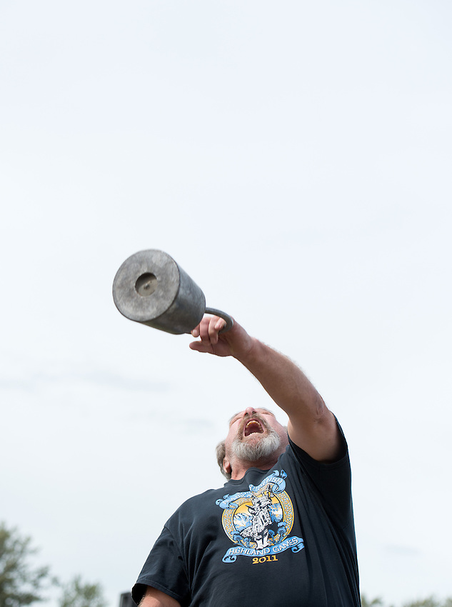 Pat Easter competes in the weight over height event during the 2015 Alaska Scottish Highland Games at the Palmer fairgrounds.