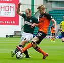 Hibs' David Gray and Dundee Utd's Stuart Armstrong challenge for the ball.
