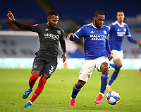 26th December 2020; Cardiff City Stadium, Cardiff, Glamorgan, Wales; English Football League Championship Football, Cardiff City versus Brentford; Junior Hoilett of Cardiff City and Rico Henry of Brentford challenge for the ball