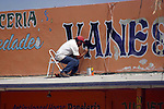 SIGN MAKER RETOUCHES ROOFTOP