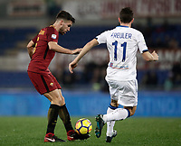 Calcio, Serie A: AS Roma - Atalanta, Roma, stadio Olimpico, 6 gennaio 2018.<br /> AS Roma's Kevin Strootman (l) in action with Atalanta's Remo Marco Freuler (r) during the Italian Serie A football match between AS Roma and Atalanta at Rome's Olympic stadium, January 6 2018.<br /> UPDATE IMAGES PRESS/Isabella Bonotto