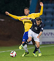 Dundee's Nicky Riley tries to get away from Cowdenbeath's Kane Hemmings.