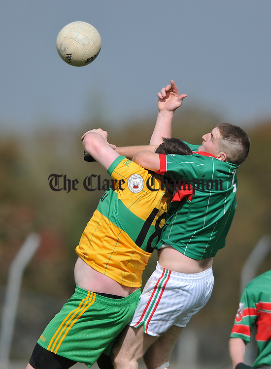 Mark Roche of O Curry's in action against Pat Sexton of Kilmurry Ibrickane during their intermediate semi-final at Kilrush. Photograph by John Kelly.