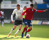 17th October 2020; Liberty Stadium, Swansea, Glamorgan, Wales; English Football League Championship Football, Swansea City versus Huddersfield Town; Christopher Schindler of Huddersfield Town and Viktor Gyokeres of Swansea City challenge for the ball