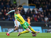 2nd October 2021;  Turf Moor, Burnley, Lancashire, England; Premier League football, Burnley versus Norwich City: Kenny McLean of Norwich City tackles Dwight McNeil of Burnley