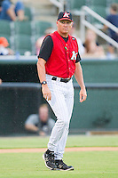 Kannapolis Intimidators pitching coach Larry Owens #14 talks a walk to the mound at Fieldcrest Cannon Stadium August 18, 2010, in Kannapolis, North Carolina.  Photo by Brian Westerholt / Four Seam Images