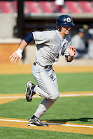 Justin Leeson #14 of the Georgetown Hoyas hustles down the first base line against the Delaware State Hornets at Gene Hooks Field on February 26, 2011 in Winston-Salem, North Carolina.  Photo by Brian Westerholt / Four Seam Images