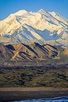 Mt Denali, (Denali) North and South peaks of North America's highest mountain, summer, Muldrow glacier moraine and Thorofare river in foreground, Denali National Park, Alaska