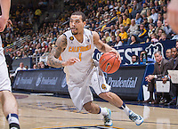 California's Justin Cobbs drives around the court during a game at Haas Pavilion in Berkeley, California on March 8th, 2014. California defeated Colorado 66 - 65