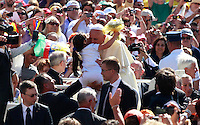 Papa Francesco saluta una bambina al suo arrivo all'udienza generale del mercoledi' in Piazza San Pietro, Citta' del Vaticano, 4 giugno 2014.<br /> Pope Francis greets a child as he arrives for his weekly general audience in St. Peter's Square at the Vatican, 4 June 2014.<br /> UPDATE IMAGES PRESS/Isabella Bonotto<br /> <br /> STRICTLY ONLY FOR EDITORIAL USE