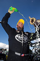 Sept. 2, 2013; Clermont, IN, USA: NHRA top fuel dragster driver Shawn Langdon celebrates after winning the US Nationals at Lucas Oil Raceway. Mandatory Credit: Mark J. Rebilas-