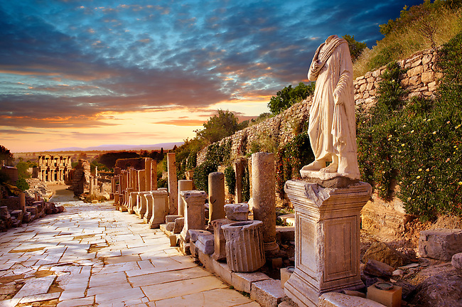Statue on  Curetes Street looking towards the Library of Celsus. Ephesus Archaeological Site, Anatolia, Turkey.