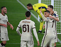 Football: Europa League - quarter finals 2nd leg AS Roma vs Ajax, Olympic Stadium. Rome, Italy, March 15, 2021.<br /> Roma's Edin Dzeko (R) celebrates after scoring with his teammates Lorenzo Pellegrini (second R), Riccardo Calafiori (second L), Jordan Veretout (L)  during the Europa League football match between Roma at Rome's Olympic stadium, Rome, on April 15, 2021.  <br /> UPDATE IMAGES PRESS/Isabella Bonotto