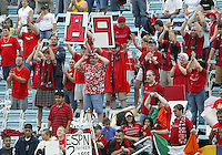 26 June 2004:   Dallas Burn Fans celebrate Jason Kreis' 89th goal against DC United at Cotton Bowl in Dallas, Texas.   DC United and Dallas Burn are tied 1-1 after the game.   Credit: Michael Pimentel / ISI