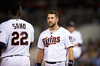 Minnesota Twins third baseman Trevor Plouffe (24) talks with Miguel Sano (22) in between innings during a Spring Training game against the Boston Red Sox on March 16, 2016 at Hammond Stadium in Fort Myers, Florida.  Minnesota defeated Boston 9-4.  (Mike Janes/Four Seam Images)