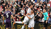 SWANSEA, WALES - MAY 17: Gylfi Sigurdsson of Swansea (2nd L) celebrates his goal with team mate Jefferson Montero during the Premier League match between Swansea City and Manchester City at The Liberty Stadium on May 17, 2015 in Swansea, Wales. (photo by Athena Pictures/Getty Images)