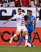 PHILADELPHIA, PA - JUNE 30: Aaron Long #23 battles Jafar Arias #19 for the ball during a game between Curacao and USMNT at Lincoln Financial Field on June 30, 2019 in Philadelphia, Pennsylvania.
