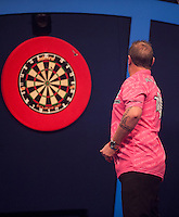 21.12.2014.  London, England.  William Hill World Darts Championship.  Dean Winstanley (26) [ENG] in action during his match against Wayne Jones [ENG]. Winstanley won the match 3-2