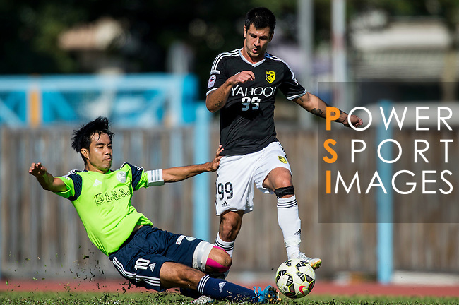 Aleksandar Randelovic of Sun Pegasus FC (R) being fouled by Chi Hing Lui of Wofoo Tai Po (L) during the HKFA Premier League between Wofoo Tai Po vs Sun Pegasus at the Tai Po Sports Ground on 22 November 2014 in Hong Kong, China. Photo by Aitor Alcalde / Power Sport Images