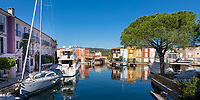 Port Grimaud lake city colorful houses, sailing boats and yachts reflecting in the blue sea, in the gulf of Saint-Tropez, Azure Coast France