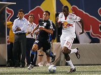 Arturo Alvarez (10) of the San Jose Earthquakes  and Macoumba Kandji (10) of the New York Red Bulls. The New York Red Bulls defeated the San Jose Earthquakes 4-1 during a Major League Soccer match at Giants Stadium in East Rutherford, NJ, on May 8, 2009.
