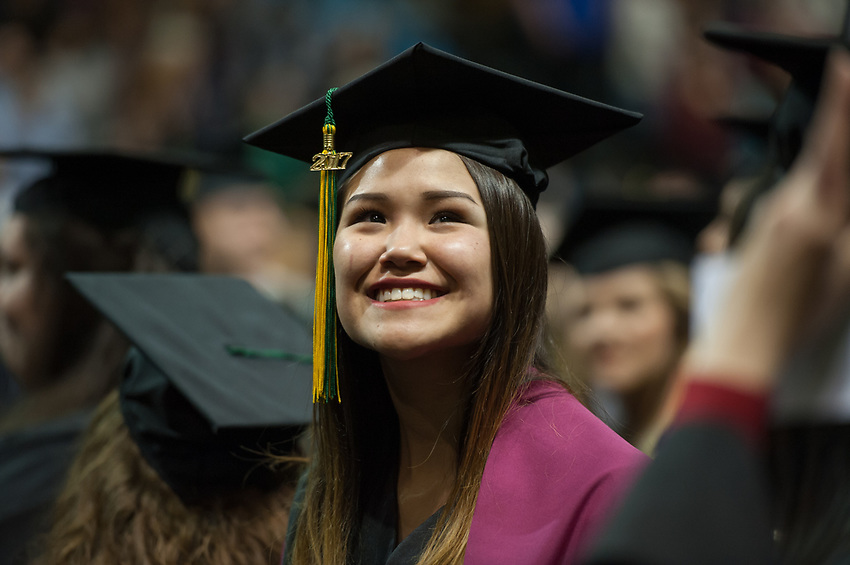 Jasmine Bourne, Bachelor's of Business Administration, Management, waits to receive her degree during the UAA 2017 Fall Commencement.