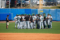 Dartmouth Big Green head coach Bob Whalen (center) addresses his team after a game against the Bradley Braves on March 21, 2019 at Chain of Lakes Stadium in Winter Haven, Florida.  Bradley defeated Dartmouth 6-3.  (Mike Janes/Four Seam Images)