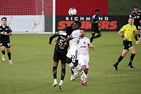 RICHMOND, VA - SEPTEMBER 30: Akeem Ward #30 of North Carolina FC and Serge Ngoma #81 of New York Red Bulls II challenge for a header during a game between North Carolina FC and New York Red Bulls II at City Stadium on September 30, 2020 in Richmond, Virginia.
