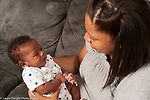 newborn baby boy 7 weeks old listening to his mother talk to him