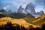 Early morning sunlight penetrating a partially clouded sky illuminated the low hills surrounding the spire of Fitz Roy in alternating bands of light and shade, Argentina.
