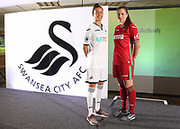 Pictured: Katy Hosford (RED) and Alicia Powe (WHITE) of the Swansea City FC Ladies' team model the home and away kits. Monday 19 June 2017<br /> Re: Swansea City FC launch their new home and away kits and announce Letou as their new sponsor at the Liberty Stadium, Swansea, Wales, UK.