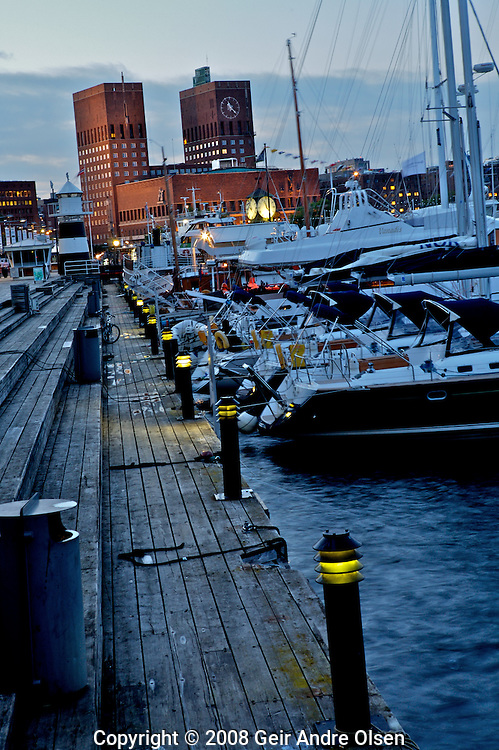 Akerbrygge, famous reataurant area in Oslo, Norway, overlooking the city hall
