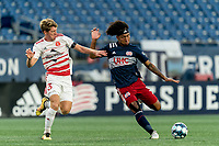 FOXBOROUGH, MA - AUGUST 21: Isaac Angking #5 of New England Revolution II dribbles as Scott Thomsen #3 of Richmond Kickers closes during a game between Richmond Kickers and New England Revolution II at Gillette Stadium on August 21, 2020 in Foxborough, Massachusetts.