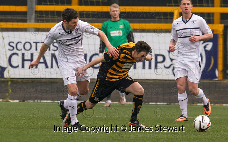 Alloa's Kevin Cawley is pulled back y Raith Rovers' Liam Fox.