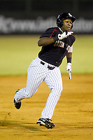 Courtney Hawkins (12) of the Kannapolis Intimidators hustles towards third base against the West Virginia Power at CMC-Northeast Stadium on August 17, 2012 in Kannapolis, North Carolina.  (Brian Westerholt/Four Seam Images)