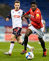 Bolton Wanderers' Tom White competing with Salford City's Di'Shon Bernard (right) <br /> <br /> Photographer Andrew Kearns/CameraSport<br /> <br /> The EFL Sky Bet League Two - Bolton Wanderers v Salford City - Friday 13th November 2020 - University of Bolton Stadium - Bolton<br /> <br /> World Copyright © 2020 CameraSport. All rights reserved. 43 Linden Ave. Countesthorpe. Leicester. England. LE8 5PG - Tel: +44 (0) 116 277 4147 - admin@camerasport.com - www.camerasport.com