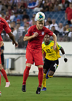 NASHVILLE, TN - JULY 3: Michael Bradley #4 heads the ball during a game between Jamaica and USMNT at Nissan Stadium on July 3, 2019 in Nashville, Tennessee.