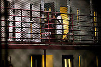A detainee outside his cell in Camp 6 at the American naval base at Guantanamo Bay, where over 600 alleged al Qaeda members have been held indefinitely. Described by the US as 'unlawful enemy combatants', they were captured primarily in Afghanistan during the 'war against terror'.