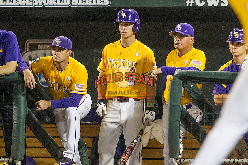 LSU Tigers (L to R) Assistant Coach Andy Cannizaro (11), shortstop Alex Bregman (8) and Head Coach Paul Mainieri (1) watch the action from the dugout against the TCU Horned Frogs in Game 10 of the NCAA College World Series on June 18, 2015 at TD Ameritrade Park in Omaha, Nebraska. TCU defeated the Tigers 8-4, eliminating LSU from the tournament. (Andrew Woolley/Four Seam Images)