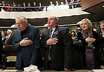 Former Assembly Speaker Joe Dini, left, and his wife Mouryne, right, and Assemblyman Tom Grady, R-Yerington, say the Pledge of Allegiance before Nevada Gov. Brian Sandoval's State of the State address at the Legislature in Carson City, Nev., on Wednesday, Jan. 16, 2013. (AP Photo/Cathleen Allison)