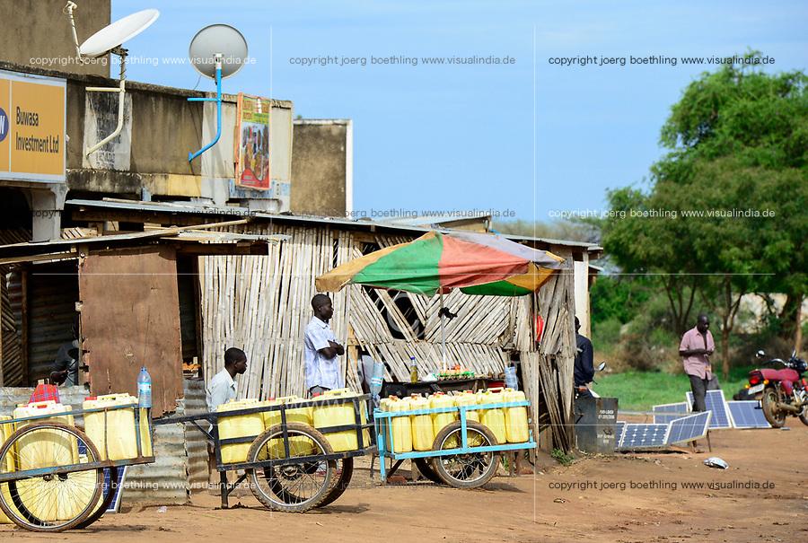 UGANDA, Karamoja, Kotido, Karamojong pastoral tribe, jerry cans for water transport and solar panels for power generation and battery recharging