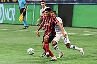 ATLANTA, GA - AUGUST 29: Miles Robinson #12 of Atlanta United passes the ball during a game between Orlando City SC and Atlanta United FC at Marecedes-Benz Stadium on August 29, 2020 in Atlanta, Georgia.