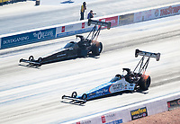Nov 3, 2019; Las Vegas, NV, USA; NHRA top fuel driver Clay Millican (near) alongside Mike Salinas during the Dodge Nationals at The Strip at Las Vegas Motor Speedway. Mandatory Credit: Mark J. Rebilas-USA TODAY Sports