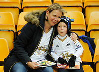 Swansea City fans enjoy the atmosphere during the Barclays Premier League match between Norwich City and Swansea City played at Carrow Road, Norwich on November 6th 2015