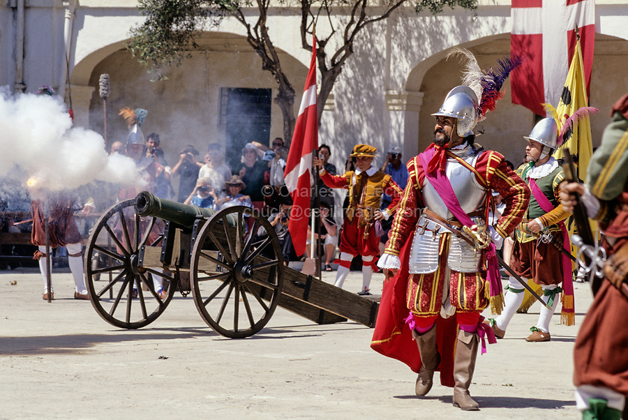 Valletta, Malta. Participants in Costume firing Cannon for Historic In Guardia Re-enactment, Fort Saint Elmo.