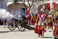 Valletta, Malta. Participants in Costume firing Cannon for Historic In Guardia Re-enactment, Fort Saint Elmo.