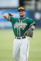 Rony Cabrera (2) of the Greensboro Grasshoppers warms up in the outfield prior to the game against the Kannapolis Intimidators at CMC-Northeast Stadium on June 9, 2015 in Kannapolis, North Carolina.  The Intimidators defeated the Grasshoppers 6-4.  (Brian Westerholt/Four Seam Images)
