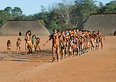 Xingu Indigenous Park, Mato Grosso State, Brazil. Aldeia Waura; a ceremonial dance in front of the House of the Flutes in honour of a recently deceased elder.