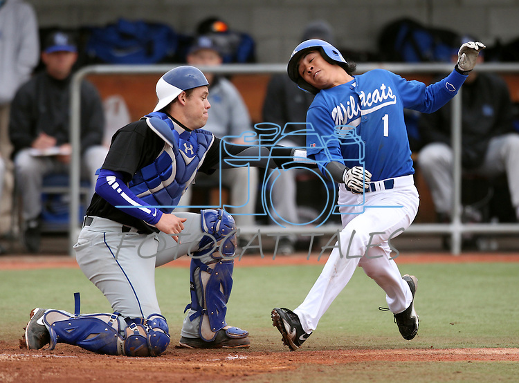 South Mountain Community College's catcher TC Marks tags out Wildcats' Tony Roque in the first game of a doubleheader against , at WNC in Carson City, Nev., on Friday, Jan. 25, 2013. WNC won the first game 5-1..Photo by Cathleen Allison