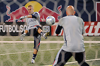 New England Revolution goalkeeper Brad Knighton (24) helps to warm up goalkeeper Matt Reis (1) before the game. The New York Red Bulls and the New England Revolution played to a 1-1 tie during a Major League Soccer match at Giants Stadium in East Rutherford, NJ, on September 18, 2009.